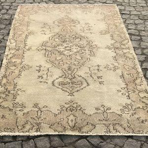 beige overdyed rug
