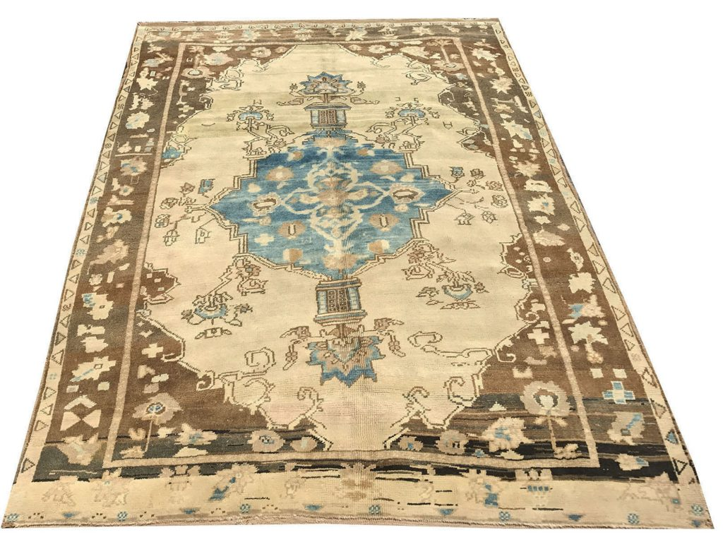 faded oushak rug