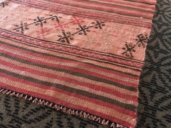 faded kilim rug