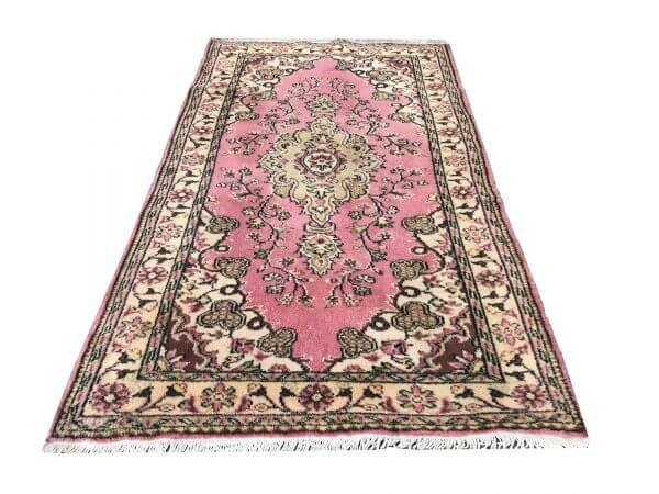 faded pink rug