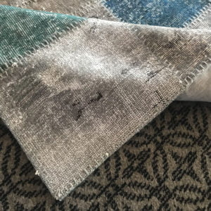 gray patcwork rug