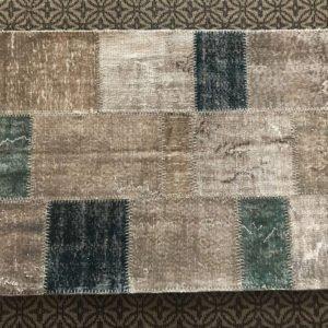 gray patcwork rug