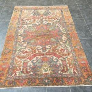 ethnic faded rug